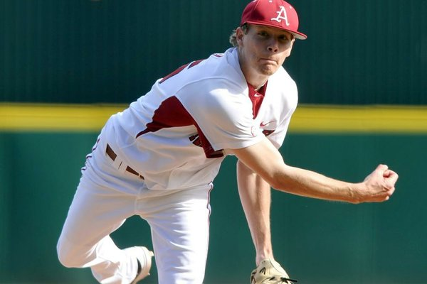 Arkansas Democrat-Gazette/MICHAEL WOODS  --03/09/2012--   University of Arkansas pitcher Ryne Stanek fires a pitch in the third inning of a game at Baum Stadium in Fayetteville.