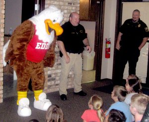 Eddie Eagle visited with Glenn Duffy second graders at the police station in Gravette. Officers Chuck Skaggs and Brad Harris introduced Eddie to the children to team them about gun safety.