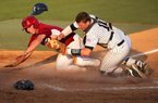 Arkansas' Tim Carver is out at home in a collision with Rice catcher Craig Manuel during the sixth inning of an NCAA college baseball tournament regional game Saturday, June 2, 2012, in Houston.