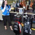 Mercedes Moseley, an employee at the Goodwill store in Springdale, examines golf clubs that had belo...