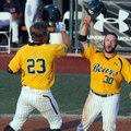 Baylor's Dan Evatt (23) slaps helmets with teammate Josh Ludy (30) after his two-run home run agains...