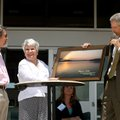 David Lewis, left, and Helen Lewis accept a Beaver Lake print Tuesday from Bill Watkins, Beaver Wate...