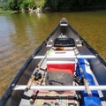 Traveling light helped the solo-paddled boats float higher. Lawn chairs are a luxury at lunch.      ...