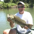 Jeff Fletcher, a Kings River fishing guide, shows a trophy smallmouth bass he caught during a float ...