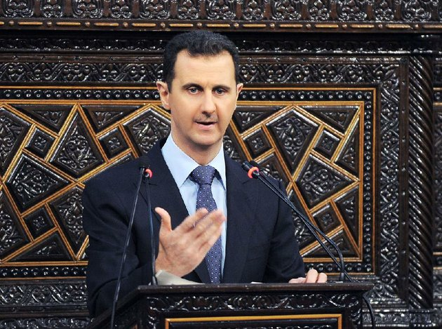 in-this-photo-released-by-the-syrian-official-news-agency-sana-shows-syrian-president-bashar-assad-as-he-delivers-a-speech-at-the-parliament-in-damascus-syria-sunday-june-3-2012-the-presidents-first-comments-on-the-massacre-expressed-horror-over-the-deaths-of-more-than-100-people-nearly-half-of-them-children-un-investigators-say-there-are-strong-suspicions-that-pro-government-gunmen-carried-out-the-killings-but-assad-denied-that-ap-photosana