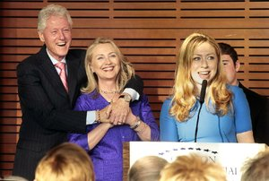Chelsea Clinton will take part in a Global Youth Services Day at the Clinton Presidential Center on Friday. In this file photo, Clinton, with her father, former President Bill Clinton, and her mother, former Secretary of State Hillary Rodham Clinton, talks about an exhibit about her grandmothers during a preview Sunday at the Clinton Presidential Center in Little Rock.