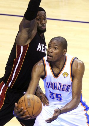 Oklahoma City Thunder forward Kevin Durant (35) tries to shoot around Miami Heat forward LeBron James during the second half of Thursday's Game 2 of the NBA Finals in Oklahoma City.The two star forwards have been making the series interesting for fans.