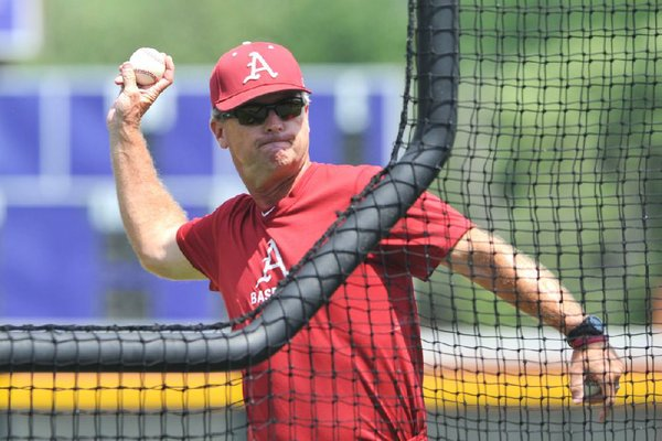 Arkansas Democrat-Gazette/MICHAEL WOODS --06/17/2012--  University of Arkansas coach Dave Van Horn throws batting practice Sunday afternoon at Bellevue East High School in Bellevue, Nebraska.