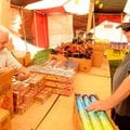 Susan Mathews and husband, Larry, stock the Rainbow Fireworks stand Saturday getting ready for its W...
