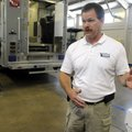 Russell Hinds, Bentonville Bomb Squad commander, talks Thursday about the squad's new headquarters a...