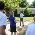 Seth Mims, a partner with Specialized Real Estate Group, shows city officials and community members ...