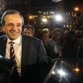Leader of the New Democracy conservative party Antonis Samaras leaves an elections kiosk after speak...