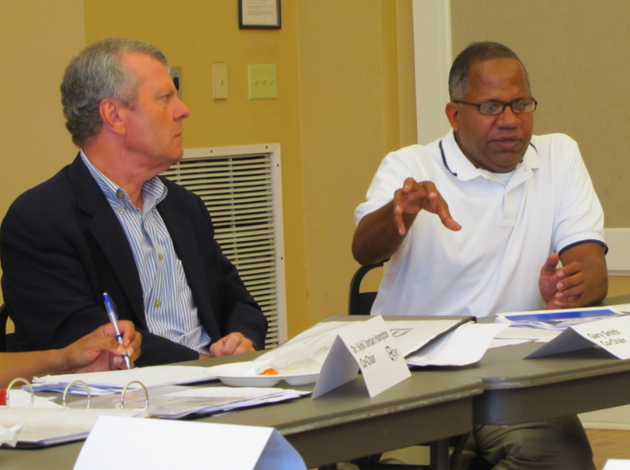city-manager-bruce-moore-right-speaks-during-the-lr-cent-meeting-wednesday-while-gary-smith-co-chair-of-the-committee-looks-on