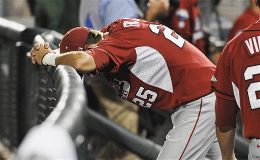 Arkansas' Dominic Ficociello (25) stands dejected after losing 3-2 to South Carolina in an NCAA College World Series baseball elimination game in Omaha, Neb., Friday, June 22, 2012. South Carolina won 3-2 and advances to play Arizona in the championship series. (AP Photo/Eric Francis)