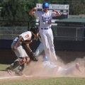 Trey Spencer of the Fayetteville Lindsey Dodgers jumps and cheers as Spencer Boudrey slides into hom...