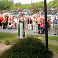 Pastor Darrel Johnson, center, leads members of the United Lutheran Church in the Pledge of Allegian...