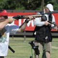 (Above) Brett Pomeroy of Fayetteville shoots Friday in the Cancer Challenge Trap Shoot in Bella Vist...