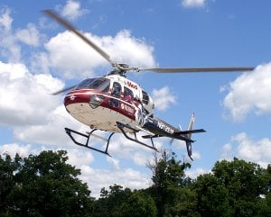 An EagleMed helicopter lifts off from Ozarks Community Hospital in Gravette on Friday after state EMS certification. Three regional helicopters were brought to Gravette for the Arkansas inspections.