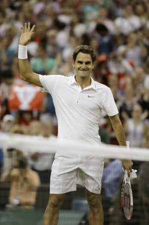 Roger Federer dropped the first two sets Friday against 29th-seeded Julien Benneteau of France, then was two points away from losing six times before coming back Friday to pull out a 4-6, 6-7 (3), 6-2, 7-6 (6), 6-1 victory in the third round in Wimbledon, England.