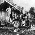 This photo of a sawmill, taken in Goshen in the early 1900s, shows the men in front holding cant hoo...