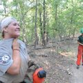 Carissa Hanson wipes away sweat after her shift with the chain saw.