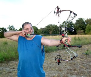 Ken Foeppel, of Centerton, took careful aim while practicing on the outdoor range Monday evening.