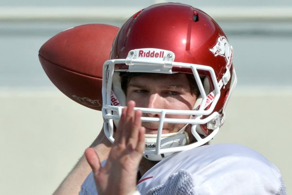 University of Arkansas quarterback Tyler Wilson runs drills during practice Tuesday afternoon at Razorback Stadium in Fayetteville.