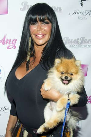 Angela Raiola, known as Big Ang, and her dog Little Louie arrive to the premiere of her VH1 reality show Big Ang.