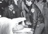 Frankie Parker is carried away from the Rogers Police Department after he was wounded during an armed standoff