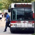 A student exits a Razorback Transit bus Monday near the University of Arkansas at Fayetteville's Nor...