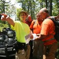 Michael Aleck with Crawford County Search and Rescue points to a path while Franklin County Search a...