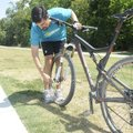 David Hecht of Bentonville takes the front wheel off his bicycle Wednesday after riding the North Be...
