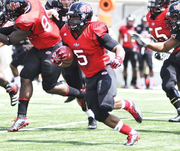 courtesy-arkansas-statehannah-dolle-arkansas-state-running-back-michael-dyer-who-transferred-from-auburn-looks-for-running-room-in-the-red-wolves-spring-game-at-asu-stadium-in-jonesboro-asu-announced-sunday-evening-that-dyer-has-been-dismissed-from-the-team-for-violating-team-rules
