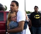 Judy Goos, left, hugs her daughters friend, Isaiah Bow, 20, an eyewitnesses, as Terrell Wallin, 20,