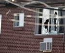 Windows are broken at the apartment of the alleged gunman James Holmes, 24, Friday, July 20, 2012 in