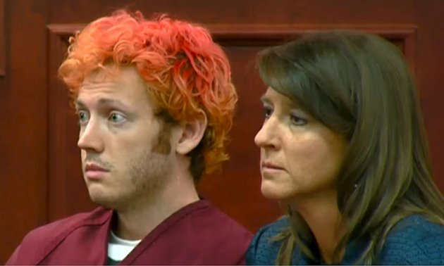 in-this-image-taken-from-video-provided-by-kusacom-james-holmes-left-the-suspected-gunman-the-aurora-colo-theater-massacre-makes-his-first-appearance-in-court-with-his-attorney-tamara-brady-in-centennial-colo-on-monday-july-23-2012