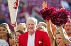 Former Arkansas athletic director Frank Broyles is shown here calling the hogs with the Arkansas spirit squad before the start of an NCAA college football game against Auburn in 2011. Frank Broyles didn't have to be a native Arkansan to be a lifetime Arkie.