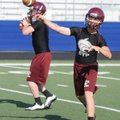 Drew Harris, right, and Dakota Riggin, Lincoln quarterback candidates, warm up before an NWA Passing...