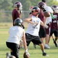 Pea Ridge quarterback Austin Easterling looks for receivers in an NWA Passing League 7-on-7 game aga...