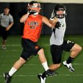 Gravette's Peyton Rose, left, looks for a pass in a VYPE 7-on-7 game against Bentonville at Tiger At...