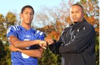 Arkansas defensive back signee Ray Buchanan Jr. (left) takes his name and his game from his father, Ray Buchanan Sr. (right).