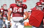 Junior center Travis Swanson is set to be the starting center for the Arkansas Razorbacks this season, but coaches Paul Petrino and Chris Klenakis said the other offensive line positions must be won through competition.