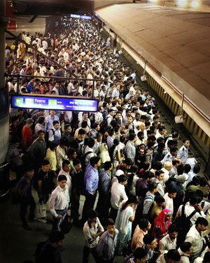 Commuters wait for a metro train Monday in New Delhi. Northern India's power grid crashed Monday, halting hundreds of trains, forcing hospitals and airports to use backup generators and leaving 370 million people sweltering in the summer heat.