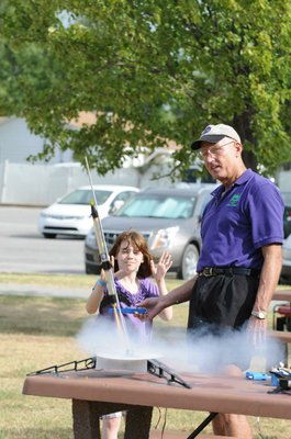 Stephen Cox with Mad Science of Arkansas launches Audrey Behar's rocket.