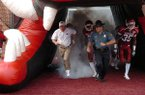 Capt. Lance King runs onto the field with former Arkansas football coach Bobby Petrino prior to a game in 2008. Arkansas State Police set new policies on Friday for troopers serving at sporting events.