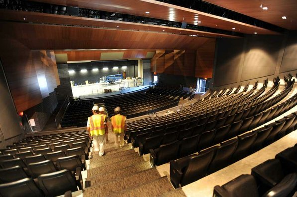 Photo by Andy Shupe—                                                                                        Officials walk through the auditorium Thursday, Aug. 3, 2012, during a tour of the additions to the Fayetteville High School building.