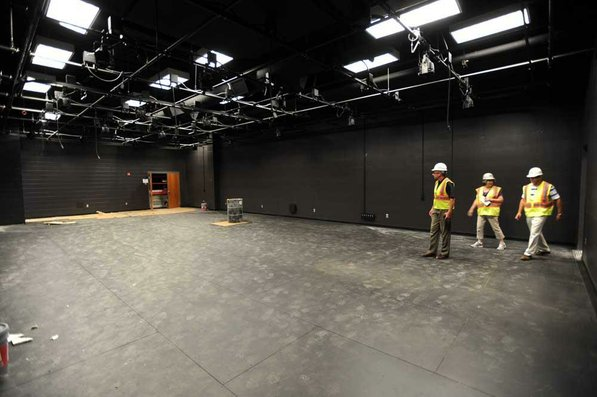 Photo by Andy Shupe—                                                                                        Officials walk through the blackbox theater Thursday, Aug. 3, 2012, during a tour of the additions to the Fayetteville High School building.