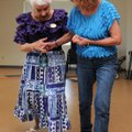 Silvia Atzeni, right, dances with Geny Handley on Friday at the Adult Wellness Center in Rogers duri...