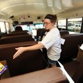Lori Hawkins, an eight-year volunteer from Springdale sorts through school supplies donated Friday o...