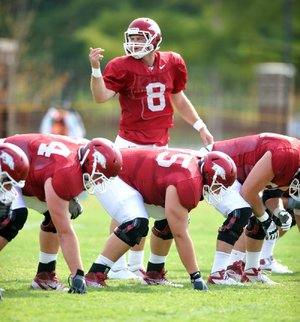 University of Arkansas quarterback Tyler Wilson completed 14 of 15 passes during the skeleton session in Sunday's practice. The full team took part in Sunday morning's practice after the newcomers had been separated out earlier in the week.